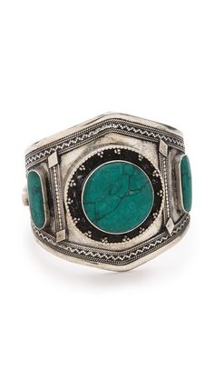 Love the aqua green accent on this antique design bracelet/cuff. Definitely a must have =)