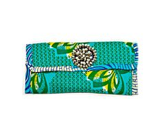 African Kente print  clutch is beautiful and functional it will hold your cell, a smaller change purse, lipstick, make up and comb.  This unique piece was designed with superb workmanship and handcrafted with quality materials.Clutch purse bag Modern African inspired clutchThis clutch has been m...
