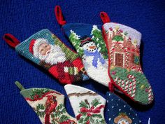 Small Needlepoint Christmas Stockings - I actually have some similar ones that I put on my tree. I always mean to actually make some myself... :)