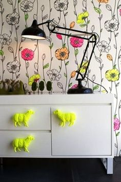 love the white background with pops of neon and bold black outlines. goes great with the white furniture and fun/funky accents.
