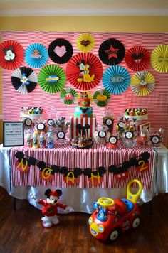 Love the table cloth back drop, mickey mouse oreos, and taco dip with mouse olives
