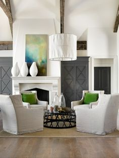 i love how the positioning of the chairs encourages conversation in this laid back living room