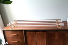 Lucite and Polished Brass Drapery Curtain Rod by LuxHoldups
