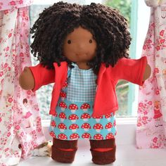 This is Ruby, a Classic Bamboletta from the March 29, 2013 upload.  She has dark skin, bobbed hair made with mohair/wool boucle in a dark brown color and brown eyes.  She is wearing the pictured outfit, underpants and wool felt shoes.