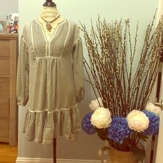 Brand NEW with Tags FEELS LIKE SILK GREY DRESS Stunning short length/long sleeves grey and white stripped dress from Banana Republic. SIZE IS XS. MEASUREMENTS: SHOULDER  TO SHOULDER: 20inches. LENGTH: 85inches. A-LINE FLOWY FIT. Double lined. Soft feel. Banana Republic Dresses Mini