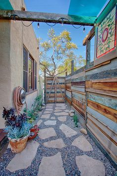 san diego landscape design using reclaimed materials like bargewood corrugated steel and salvaged hardware to