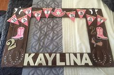 """Photo prop frame I've made from cardboard for my little sisters birthday. It's a cowgirl party, so I was going for a western look. I used wood stain and a sponge on the cardboard to create that """"wood grain"""" effect. Horse Birthday Parties, Cowgirl Birthday, Dad Birthday, Birthday Ideas, Rodeo Party, Cowboy Theme Party, Party Photo Frame, Party Frame, Cowgirl Baby Showers"""