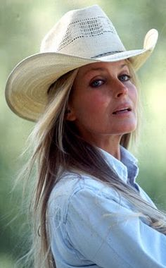 Bo Derek November 2011. Such a beautiful, sweet, petite, confident woman. She could be found doing her own grocery shopping at a market in the SYV. Locals always respected celeb space. Everyone needs to just live. She was also one of my husband's clients. Darling gal, so glad she has found love again after John.