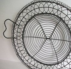 Sold as a pair these very intricate French wire baskets. Use for serving or decor.    Some chipping of paint in the pair, but they are in solid condition.    measures 16 handle to handle