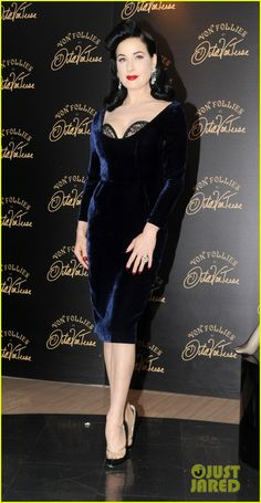 Dita Von Teese - launch of her new lingerie line Von Follies at Debenhams - custom Dita Von Teese Collection - The Showcase Dress in velvet, Christian Louboutin shoes, Valentino clutch, a Dior ring, and vintage earrings.