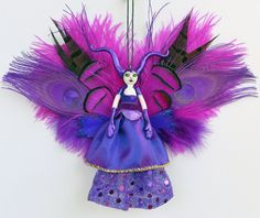 Check out this item in my Etsy shop https://www.etsy.com/uk/listing/257472380/devil-woman-fairy-peg-doll-she-devil
