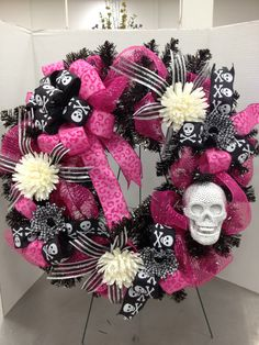 DIVA Halloween Pink & Black Wreath w/Skull  After I was given the challenge to create a Pink and Black line of product for Halloween, well lets just say I let the creativity take over...  By Christian Rebollo