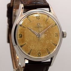 1957 Vintage Omega Stainless Steel watch with Original Heavy Patina Silver Dial with Applied Steel Arabic 3, 6, 9 , and 12 and Elongated Arrow Markers. Triple Signed. Swiss Case Very Good Case Origina