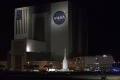 At NASA's Kennedy Space Center in Florida, the agency's Orion spacecraft passes the spaceport's iconic Vehicle Assembly Building as it is transported to Launch Complex 37 at Cape Canaveral Air Force Station on the evening of Tuesday, Nov. 11, 2014.