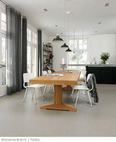 Marmoleum flooring is a durable & affordable alternative to tiling. also is laid in sheets so replicates the concrete look well and comes in a very wide range of colours and effects