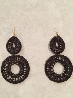 Dark brown..hand crocheted earrings.  Super cute!!! Lightweight and perfect for casual or dressy!!! Boho Style. I just love them!  www.knottinia.com