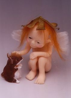 fairy doll very unique as it pets a mouse