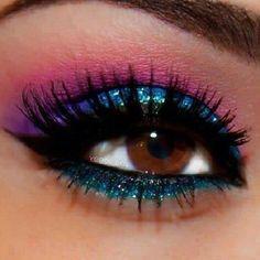 Pink, purple, and blue glitter eye makeup