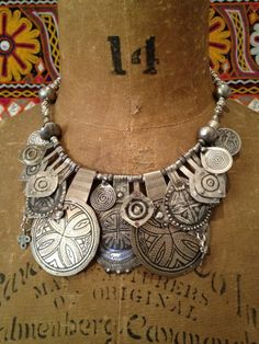 Necklace; Multi-layers of traditional silver and niello Berber amulets and old silver coins form a glamorous bib choker by Victoria Rivers
