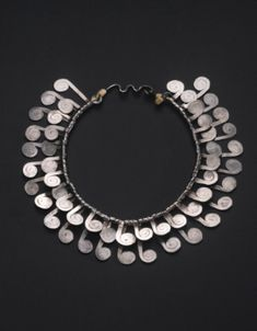 """Alexander Calder necklace. Sold, Sotheby's, 278,000 dollars, Nov. 14, 2012. """"silver wire and string 1/4 by 8 by 8 in. 0.6 by 20.3 by 20.3 cm. Executed circa 1950, this work is registered in the archives of the Calder Foundation, New York, under application number A25782."""""""