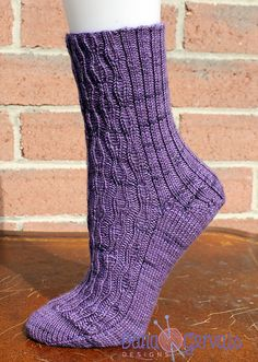 Ravelry: Moriarty Socks pattern by Dana Gervais