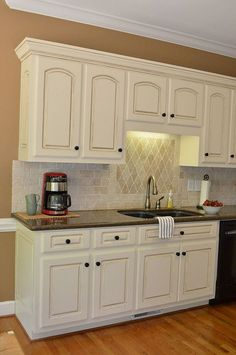 Painted Kitchen Cabinet Details Super classy... dark countertops, light cabinets withdetail, hardwoods, beige. Love the colors.