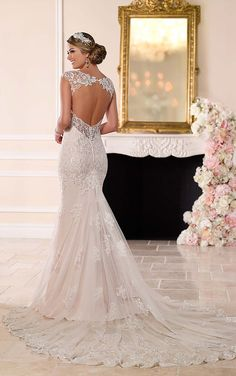 Stella York 6245 lace wedding dress over matte-side Lustre satin meets all the desires of a modern bride. From its hand-sewn clear beading, sweetheart neckline with deep V detailing, cap sleeves, and keyhole back; to its easy-close back zipper and layered train.