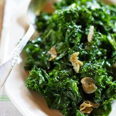 Sautéed Kale With Garlic and Olive Oil | Food & Wine; plus I'd add some sauteed mushrooms to this baby. YUMMERS!!