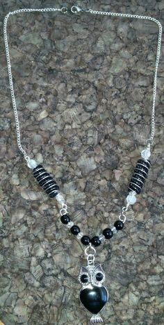 Black and silver spiral owl necklace