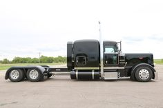 2014 Chrome Crew 2014 Peterbilt 389 Flat Top with a 63 inch flat top sleeper sitting on Low Low leaf suspension and 22.5 wheels and a 280 inch wheel base. This truck came equipped with an ISX 600 C…