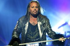 Motley Crue's Vince Neil Appears To Throw Punch at Fan During Solo ...