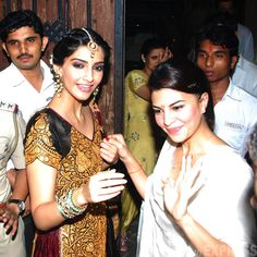 Hand-in-hand Sonam and Jacqueline wave to fans as they wish them a Happy Diwali. (Photo: Varinder Chawla)