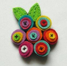 Broche flores by Lidia!felted wool flowers from old sweater/jumperThis would be awesome as a magnet! Felt Diy, Felt Crafts, Fabric Crafts, Sewing Crafts, Sewing Projects, Diy Crafts, Fabric Brooch, Felt Brooch, Felt Fabric