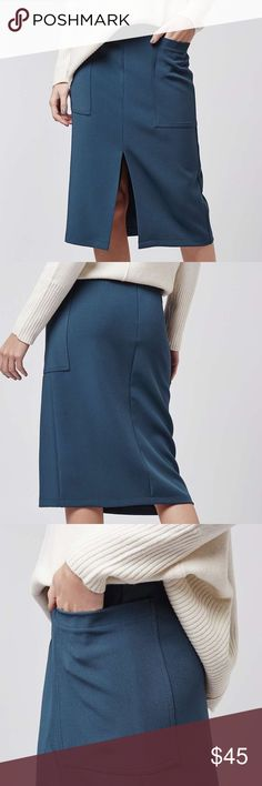 """Topshop Split Midi Skirt S77-Texture is everything this season, so embrace it wth this stunning midi skirt. With a front split and patch pockets, it comes with a D-ring belt to cinch in the waist. Wear with chunky knits and ankle boots for AW chic. 55% Viscose, 36% Wool, 9% Polyester. Machine wash. Laid flat across waist: 15.5"""", Length: 29"""". NWT Topshop Skirts Midi"""