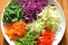 Asian Slaw Serves 4 to 6 1/4 head of red cabbage, sliced thin (about three cups) 1/4 head of savory cabbage (about 2 cups) 3 medi...