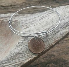 Check out this item in my Etsy shop https://www.etsy.com/listing/276269482/wheat-penny-bracelet-adjustable-bangle