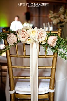 I like the idea of chairs specially decorated for the bride and groom