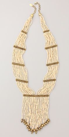 Tribal necklaces are big this summer. This Theodora & Callum piece is a great choice because it can be paired with anything!