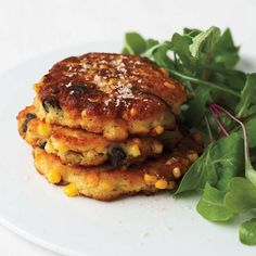 Corn and Shiitake Fritters | Sweet corn kernels take two different forms in these crispy cakes. Half the corn is pureed into the batter; the other half is sautéed with shiitake and onion to give the fritters crunch.