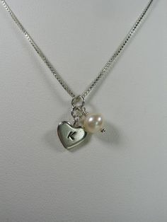 Bridesmaid necklaces with a grey rose added on to match the earrings.