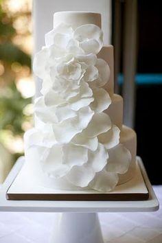 white wedding cake with ruffled flower