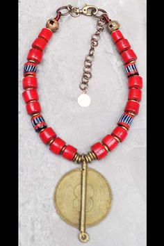 Malawi: Island Tribal Bold Red Glass and African Brass Shield Pendant Necklace African Necklace, African Jewelry, Tribal Jewelry, Jewelry Art, Jewellery, Jade Pendant, Pendant Necklace, Coin Necklace, Art Necklaces