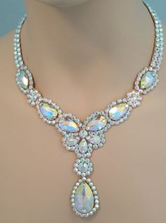 This beautiful necklace has lots of pear shaped crystals in various sizes to really create sparkle! If you would like a necklace with just a little drop this will work great! There are color options i