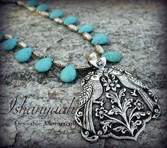 Ishanyaah: Turqouise Tear Drop and Antique Finish Pendant