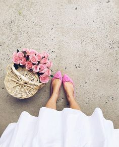 Pink flats with pink roses and a white dress
