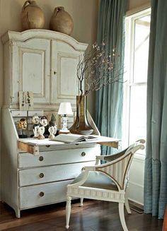 whitewash secretary, aqua drapes...& of course, the chair.