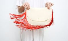 REDHEAD/+Beige+&+Red+fringe+and+leather+clutch+by+DDSLLGirlsStore,+$39.00