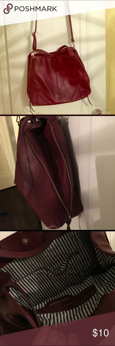 Adjustable maroon shoulder bag Leather, maroon in color. Cute and fits so much in it!!! Love that the zippers make it a little bigger or smaller depend omg on how much you're carrying! Francesca's Collections Bags Crossbody Bags