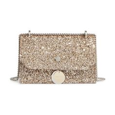 finley shadow glitter shoulder bag by Jimmy Choo. Logo-etched disk hardware in silver and golden tones echo the glittery finish on a chic shoulder bag with a jubilant ...