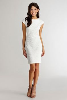 70d6a804d0a This simple white dress is perfect for a city hall wedding. Wedding Dresses  Under 500